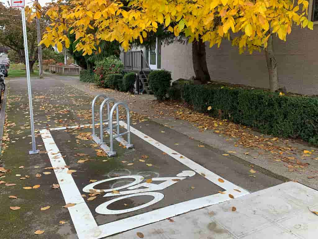 floor parking around bike stands on sidewalk